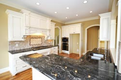 Black Granite kitchen white cabinets - Acton Mass Atlantis Marble and Granite