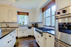 black granite white cabinets Granite kitchen - Acton Mass Atlantis Marble and Granite